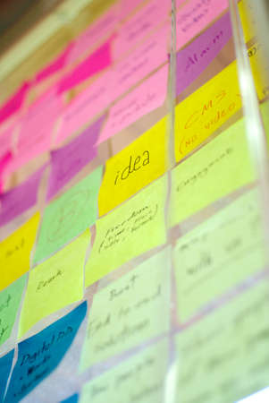 yellow sticky note: colorful post it on idea wall Stock Photo