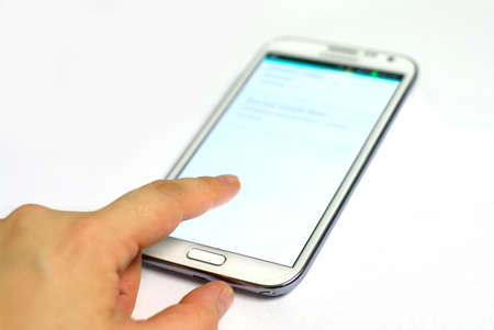 white mobile, smartphone with hand and finger photo