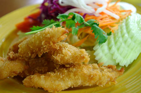fried fish and salad healthy meal photo