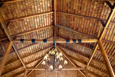 wood roof ceiling structure with chaderlier photo