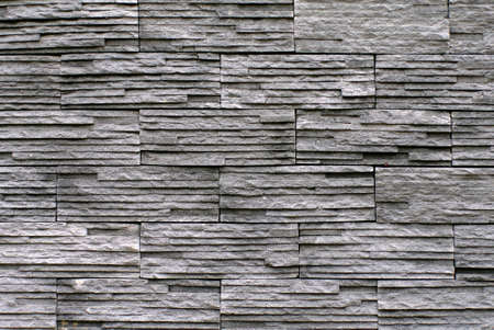 grooved: slate stone stack wall texture background