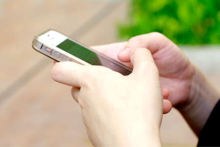 hand hold a smartphone Stock Photo