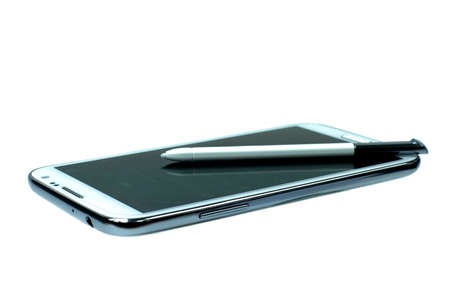 White mobile phone with stylus pen. easy to work with this device with pen and screens