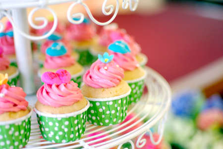 cute and colorful yummy cupcakes tier