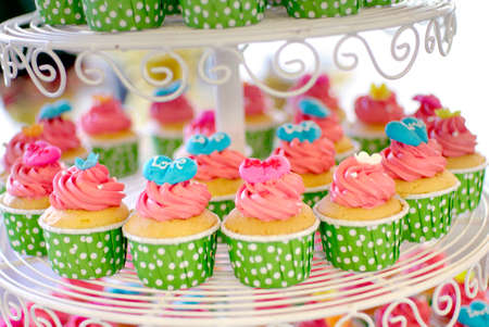 cute and colorful yummy cupcakes tier photo
