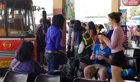 backpackers travel in thailand at bus terminal
