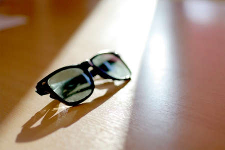 sunglasses in sun light with beautiful shadow and reflection photo