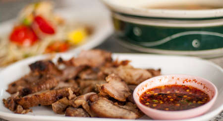 thai spicy food, griil pork and papaya salad photo