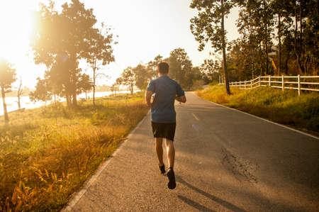 marathon runner running in the morning photo