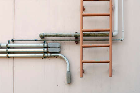 fire escape climbing stair and metal tube photo