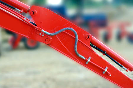 crane parts: red mechanic parts crane and tractor detail, dozer