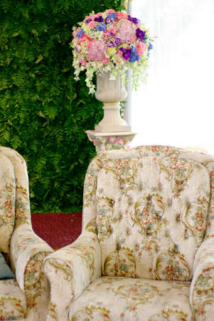 classic sofa with floral pattern with flower and green setting photo