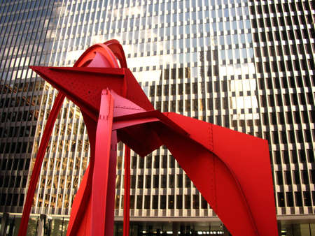 Red metal sculpture, modern working building in Chicago