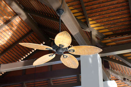 tropical wooden colonial style ceiling fan photo