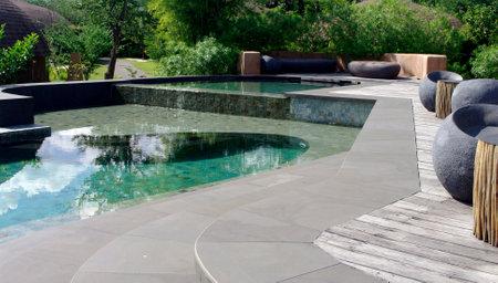 beautiful resort swimming pool in nature Редакционное