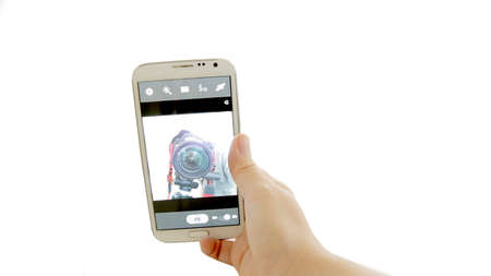 selfie photographer with smartphone on isolated background photo