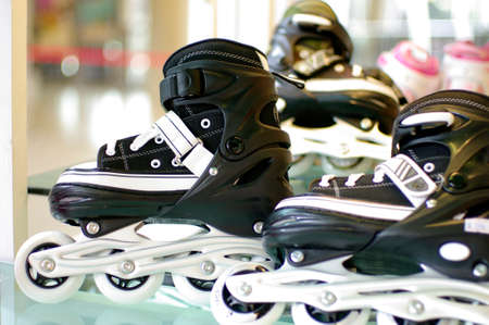 roller blade: black and white roller blade shoes Stock Photo
