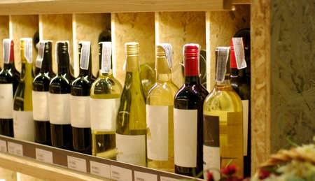 beverage display: wine bottles on wood shelf