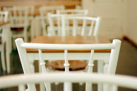 white and wood table chair cafe photo