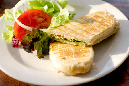 panini chicken pesto with salad photo