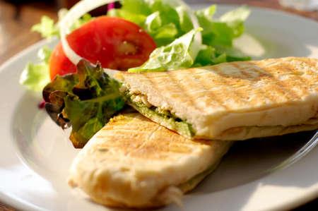 panini chicken pesto with salad Foto de archivo