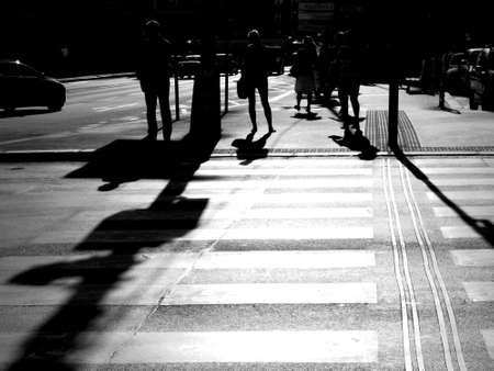 Abstract Black And White Color Photo Of People Walking Stock