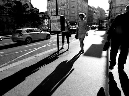 abstract black and white color photo of people walking