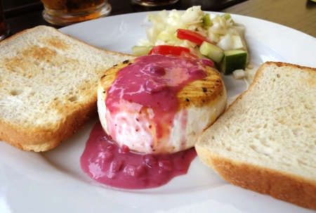 Camembert cheese plate with cranberry and picke photo