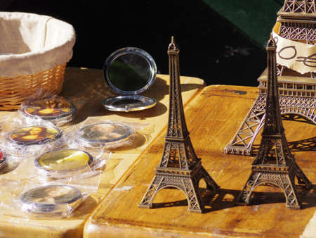 souvenirs from Paris display on street wood table photo