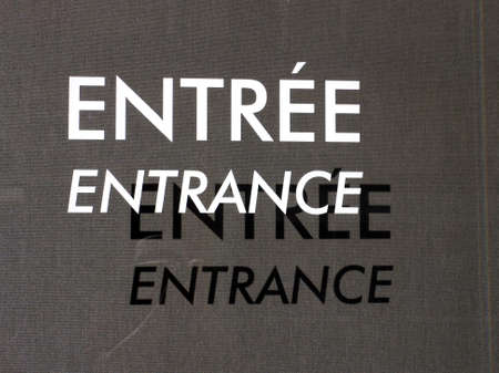 entree: entrance, entree sign on glass with shadow Stock Photo