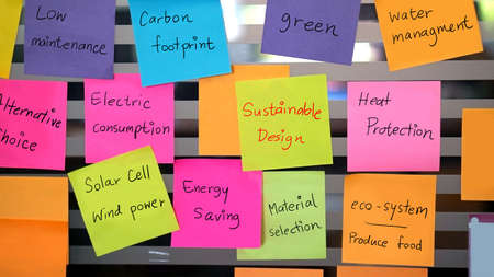 managment: sustainable, green design concept on colourful notes Stock Photo