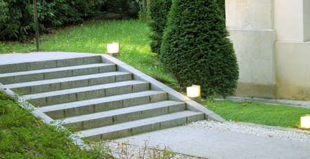 outdoor lighting: Garden landscape stair with lighting in the green grass and urban plan Stock Photo