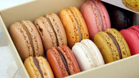 colourful macaron stack in white paper box photo