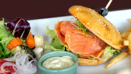 beautiful salad: smoked salmon burger with beautiful salad decoration