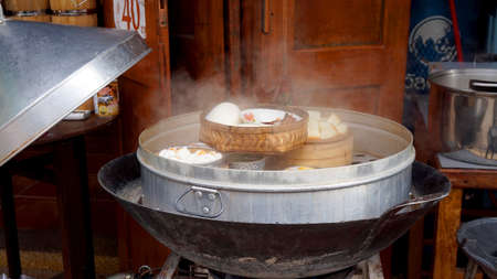 restuarant: hot fresh steaming dimsum and dumplings at classic wooden restuarant in Asia
