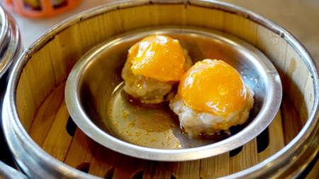 Dimsum morning tea food, steamed pork with salted egg yolk Stock Photo