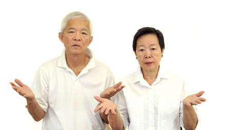 satisfy: Asian senior couple do not like a deal. Upset and do not satisfy Stock Photo