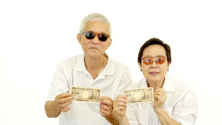 happy rich cool asian senior showing cash money japanese Yen
