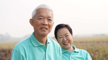 potrait: close up potrait of Asian senior couple on bright green background