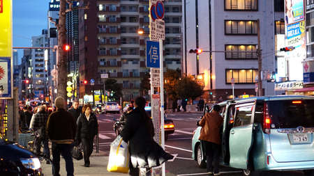 work from home: Osaka Japan - March 2015: Japanese people walking home after work in evening. Normal lifestyle