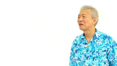 looking aside: happy asian senior guy on blue hawaii shirt looking aside on white isolate background