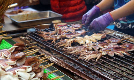 squid: Taiwan night market street food, grilled charcoal squid Stock Photo