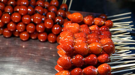 night stick: strawberry and tomato glazed on stick in Taiwan night market