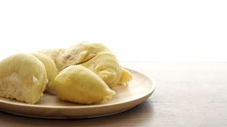 smelly: Smelly yellow ripe durian on wood plate. Tropical summer fruit with copy space