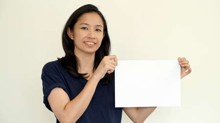 south east asian: South East Asian girl holding while sign for copy space