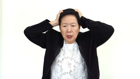 stressed out: Asian senior businesswoman stressed out