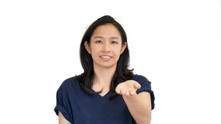 south east asian: South East Asian girl doing presentation hand gesture with  copy space