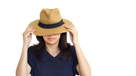 south east asian: Casual South East Asian girl wearing hat hiding her face