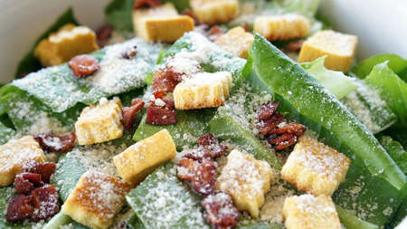 Close up shot of caesar salad, organic green vegetable with parmesan cheese and crutons Stock Photo