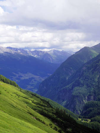 Beautiful majestic view from road trip in Europe. Mountain alp landscape with forest Stock Photo